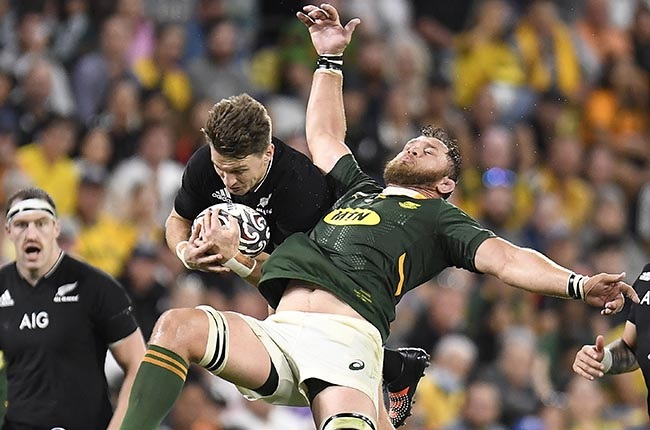 Beauden Barrett of the All Blacks contests a high ball with Duane Vermeulen of the Springboks. (Photo by Ian Hitchcock/Getty Images)