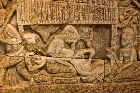 A bas relief on a temple at Angkor Wat shows a wom