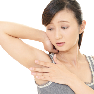 Woman looking at armpits