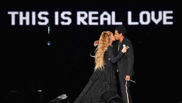 Beyonce and Jay Z sharing a kiss on stage during their current world tour.