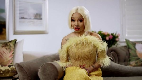 kelly khumalo blonde hair and yellow fur outfit