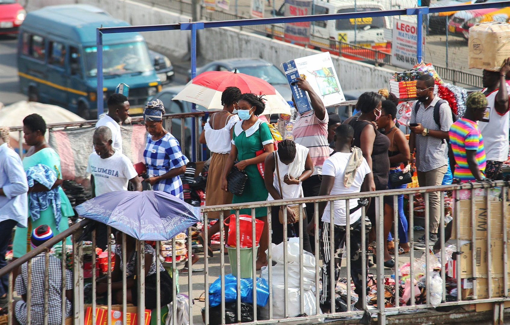 People shop at a market in Accra, Ghana during the coronavirus pandemic.