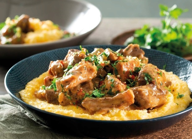 hearty meat stew with gremolata and cheddar polent