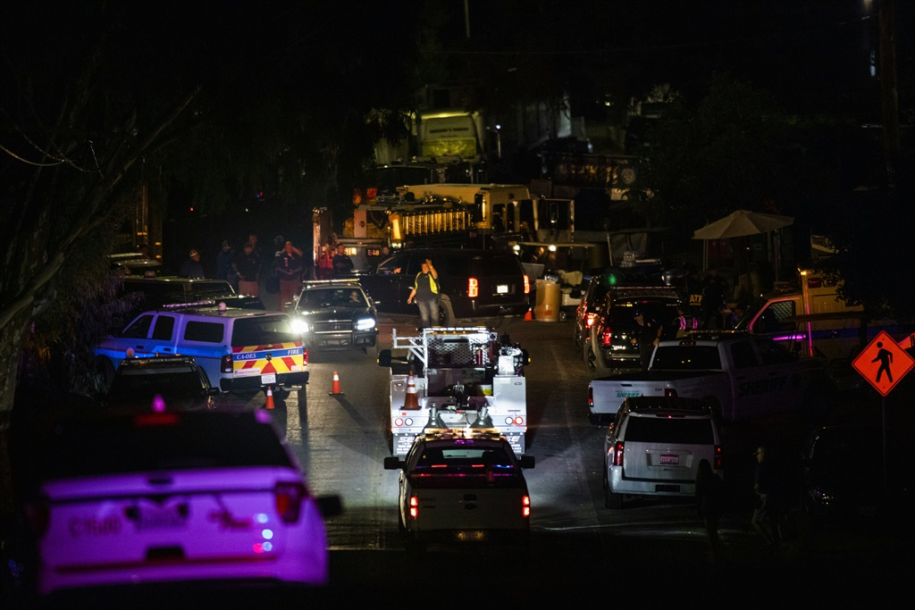 Vehicles arrive on the scene of the investigation following a deadly shooting. (AFP, file)