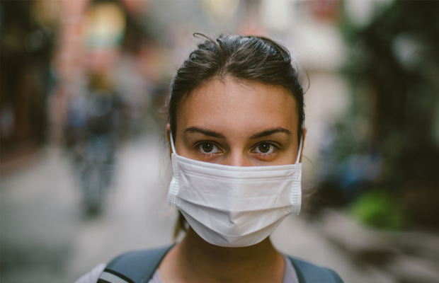Woman wearing surgical mask