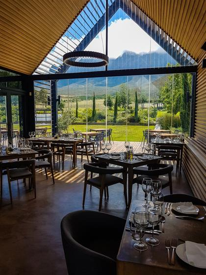 interior of a restaurant looking out on a mountain