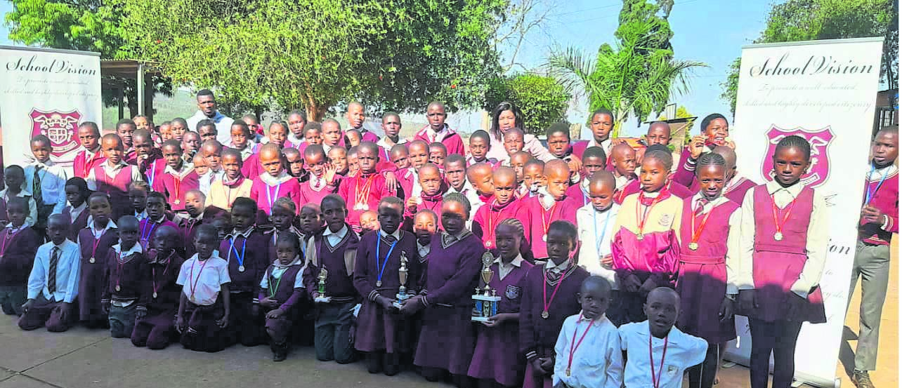 photo:suppliedTeachers (back) and pupils from Tholinhlanhla Primary embraced the day's events.