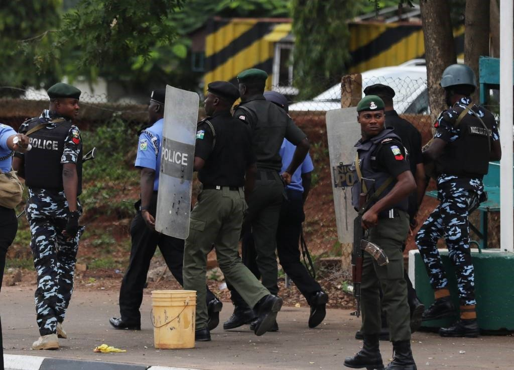 Nigerian police officers patrol in the streets.