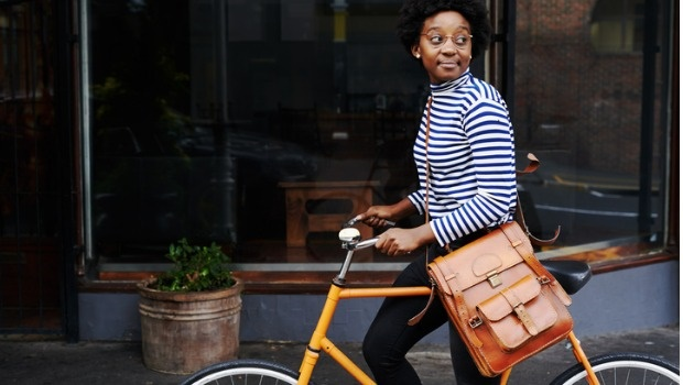 A woman explores the city on a bike