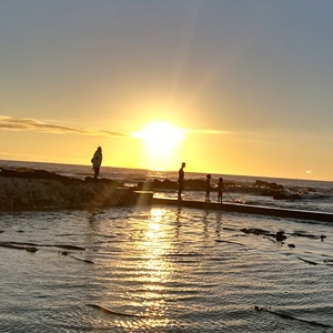 A view of the sun setting at Sea Point beach in Cape Town. (News24)