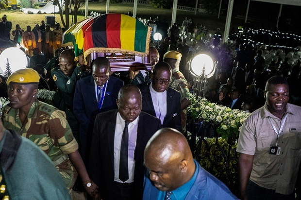 Pall bearers carry the casket of late Zimbabwean President Robert Mugabe as it arrives at his former Blue Roof residence in Harare. (Zinyange Auntony, AFP)