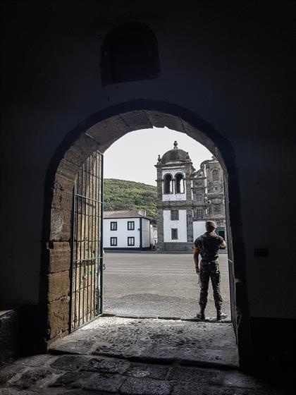 soldier stands at the entrance of old portuguese f