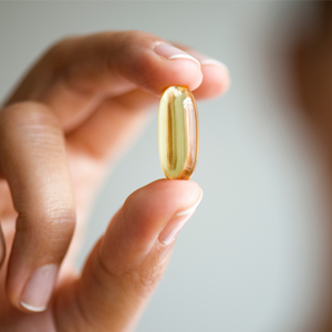 Person holding capsule supplement