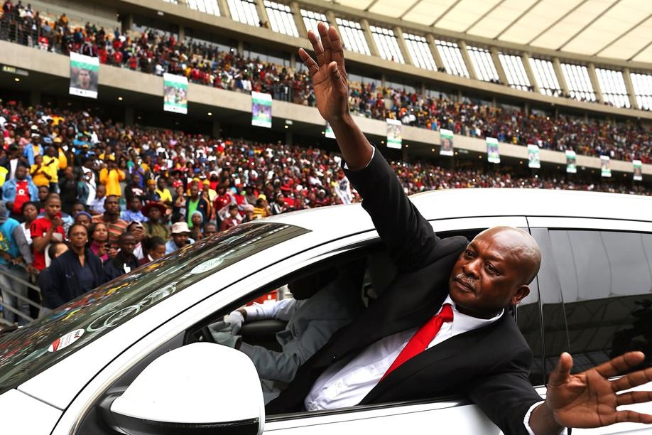 Sam Meyiwa, father of Senzo, waves to the crowd during his son's memorial service at Moses Mabhida stadium in Durban.