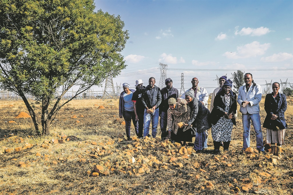 Lufhereng residents stand next to their farmland that is situated in Doornkop plot 239 IQ in Soweto. They claim to have lost their land to the Lufhereng Housing Project through nefarious practices. Picture: Mpumelelo Buthelezi