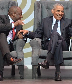 President Cyril Ramaphosa and former US president Barack Obama share a light moment during the 16th annual Nelson Mandela lecture at Wanderers Stadium on July 17, 2018. (Photo: Lefty Shivambu, Gallo Images)