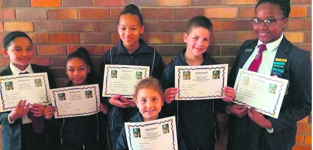 Kabega Primary School learners received four second and two third place prizes at the recent Setlaars Science Expo. In the back from left are Lameez Hartnick (second in Grade 7 technology), Shasmeen Botha (second in Grades 1-3), Simone Tobias (second in Grades 4-6 physics), Regardt Anderson (second in Grades 4-6 technology), Mitchelle Chininga (third in Grade 7 physics). In front is Lianca van Deventer (third in Grades 1-3).      Photo:SUPPLIED