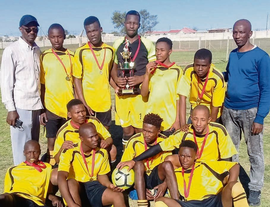 Players of Eleven Stars display their medals as they are supported by their officials.Photo:SELBY MADIKANE