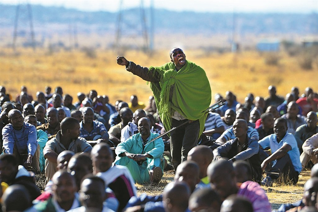 Strike leader Mgcineni Noki, also known as the man in green blanket, rallies the miners at Marikana ahead of their encounter with police that left more than 35 miners dead, shot by the police. Picture: Leon Sadiki/City Press
