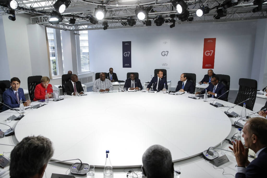 (LtoR) Canadian Prime Minister Justin Trudeau, German Chancellor Angela Merkel, South African President Cyril Ramaphosa, President of Burkina Faso Roch Marc Christian Kabore, Senegal's President Macky Sall, French President Emmanuel Macron, Egypt's President Abdel-Fattah el-Sisi and Rwanda's President Paul Kagame attend a working session on 'G7 Partnership with Africa' in Biarritz, France. (Philippe Wojazer/AFP)