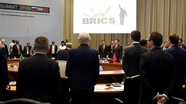 <strong>A PEEP INSIDE THE CLOSED SESSION:</strong> China's President Xi Jinping and leaders stand prior to taking their seats at the first closed session of the 10th Brics Summit at the Sandton Convention Centre in Johannesburg. (Photo: Mike Hutchings, AFP)
