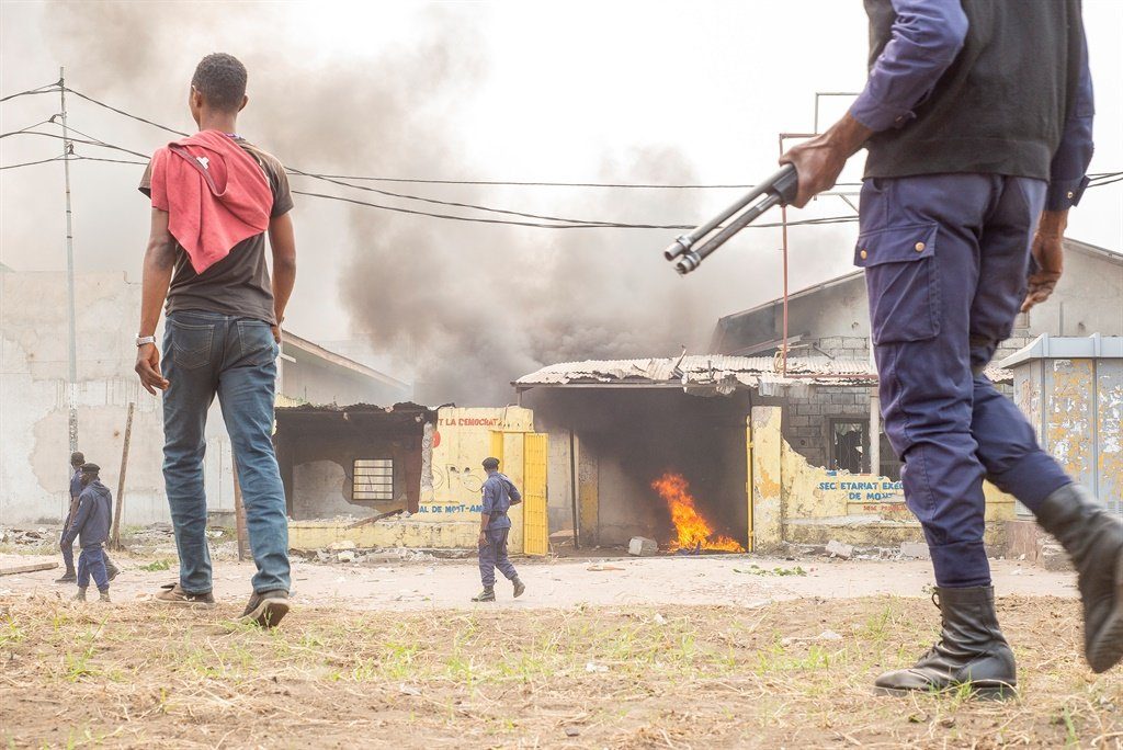 A fire is seen in a building during a protest where demonstrators and police officers clashed in Kinshasa.
