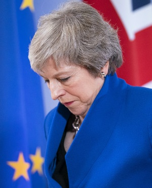 British Prime Minister Theresa May departs after