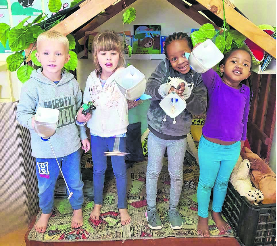 """Pupils (from left) Ryan Hillermann, Abigail Love, Nomcebo Zakwe, and Namhla Ngidi proudly show off their home-made whales from the story of """"Jonah and the whale"""".photo: supplied"""