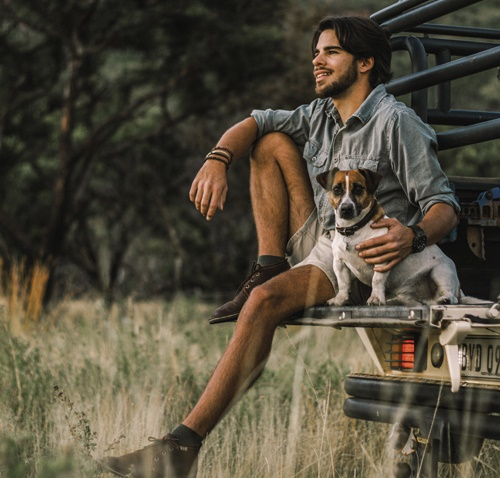 Delport with his dog, Kingsley – named after Kingsley Holgate! This photo was taken on the farm Berg en Stroom, outside Thabazimbi, where Delport lives. Photo: Courtney Robinson