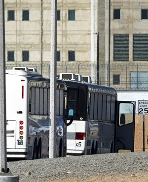 Department of Homeland Security buses with detained immigrants aboard enter the Federal Correctional Institution in Victorville, California. (James Quigg, The Daily Press via AP, File)