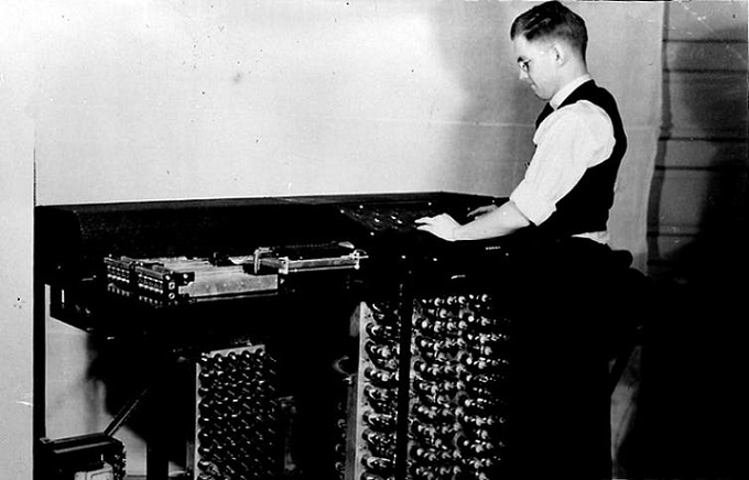 Clifford Berry stands by the Atanasoff-Berry Computer. Courtesy of Iowa State University Library Special Collections and University Archives, CC BY-ND