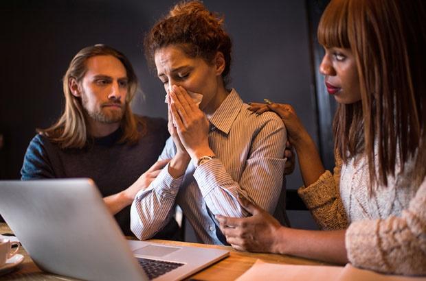 woman crying at work