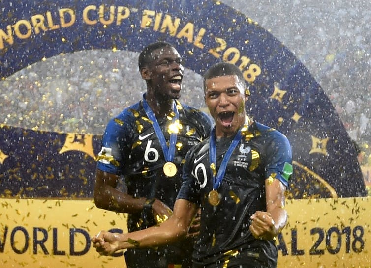 Two of France's players with African roots, Paul Pogba and Kylian Mbappé, celebrate winning the World Cup. Picture: EPA/Facundo Arrizabalaga