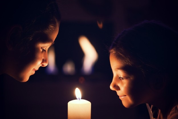 girls by candle light during power outage, load-sh