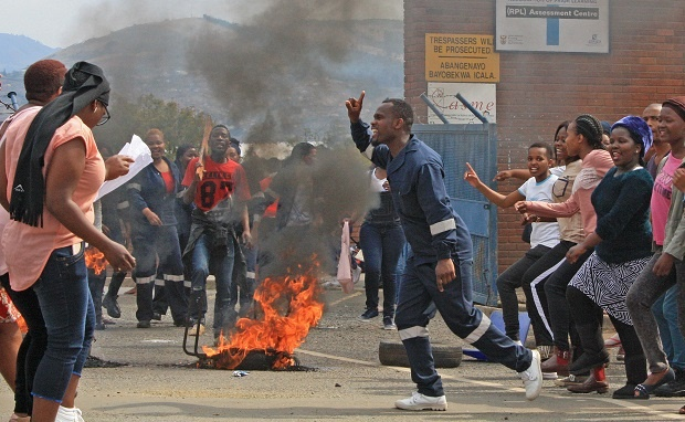 uMgungundlovu TVET students at the Plessislaer campus in Imbali on Tuesday blockaded the entrance to their campus with burning tyres as they protested against the management of their