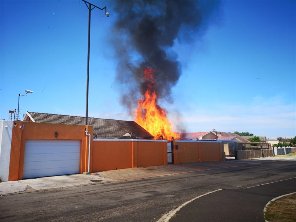 A house in Belhar burns after allegedly being petrol bombed on December 22, 2018. Sources told News24 the house belongs to Colin Booysen. (Supplied)