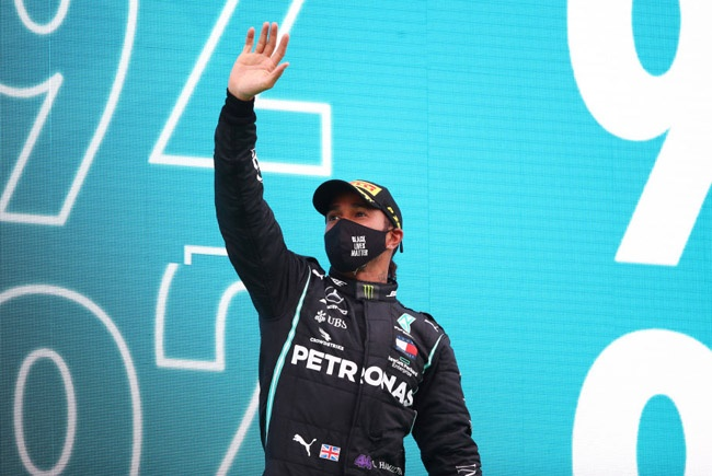 Race winner Lewis Hamilton of Mercedes GP celebrates his record breaking 92nd race win on the podium during the F1 Grand Prix of Portugal at Autodromo Internacional do Algarve on October 25, 2020 in Portimao, Portugal. (Photo by Joe Portlock/Getty Images)