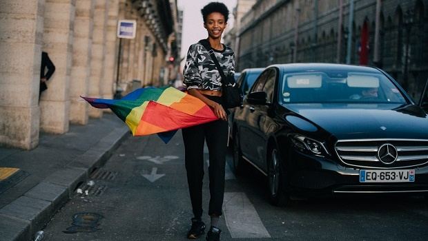 Woman carrying the LGBTQI+ flag