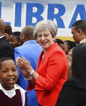 British Prime Minister Theresa May meets pupils during a visit at the the ID Mkhize High School in Gugulethu, Cape Town. (AP Photo)