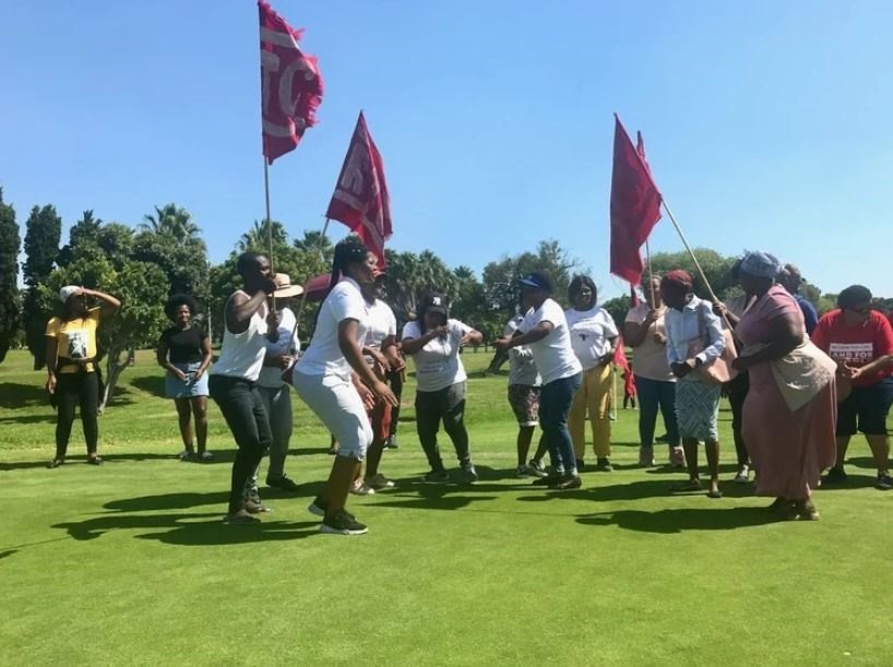 Housing activists marched on to a green at the Rondebosch Golf Club in February calling on the City of Cape Town to prioritise building affordable housing for working class people. (Archive Photo: Tariro Washinyira, GroundUp)