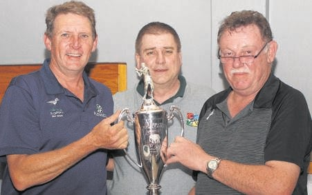 photo: supplied(From left) Fanie van Wyk, Lothar Witthoft (deputy principal of Hermannsburg School) and André Scheepers lift the trophy at the 27th HMB Golf Day, held at St Cathryn's Golf Estate.