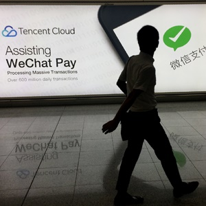 A man walks past an advertisement at Hong Kong's i