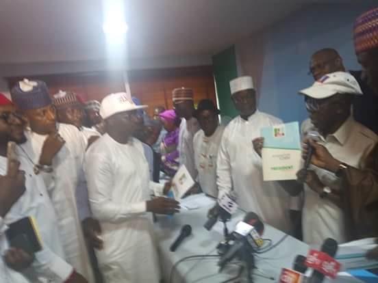 group presents check to oshiomhole