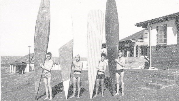 Peter Liddle (second from left) and friends, using their original surfboards.