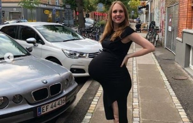 Woman pregnant with triplets shares pictures of huge tummy