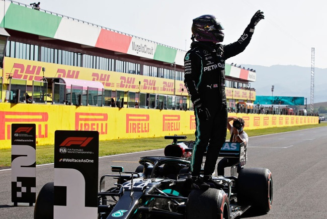 Pole position qualifier Lewis Hamilton of Great Britain and Mercedes GP celebrates in parc ferme during qualifying for the F1 Grand Prix of Tuscany at Mugello Circuit on September 12, 2020 in Scarperia, Italy. (Photo by Luca Bruno - Pool/Getty Images)