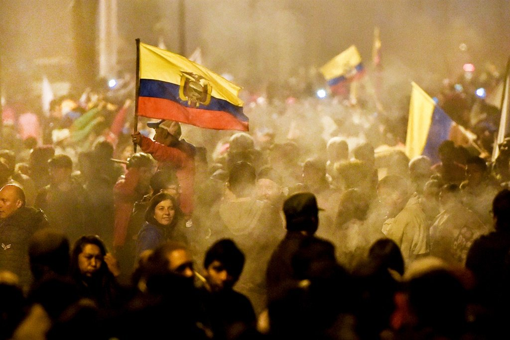 Indigenous people celebrate outside the Casa de la Cultura in Quito after Ecuador's president and indigenous leaders reached an agreement to end violent protests. (Luis Robayo, AFP)