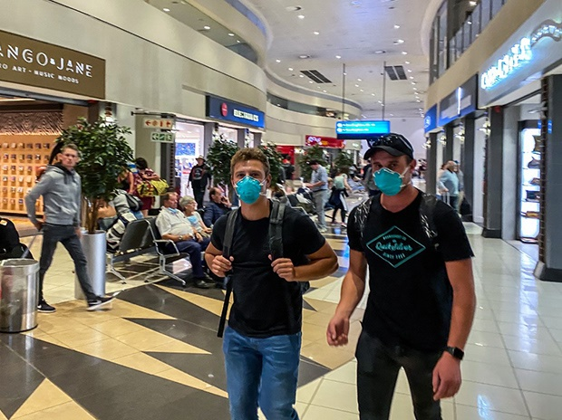 Passengers wear face masks as a preventive measure in the international departures terminal at the OR Tambo International Airport. (AFP)