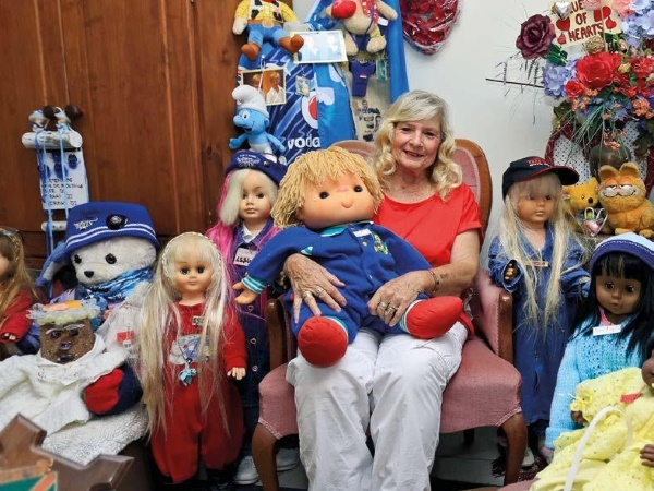 woman with over 400 dolls