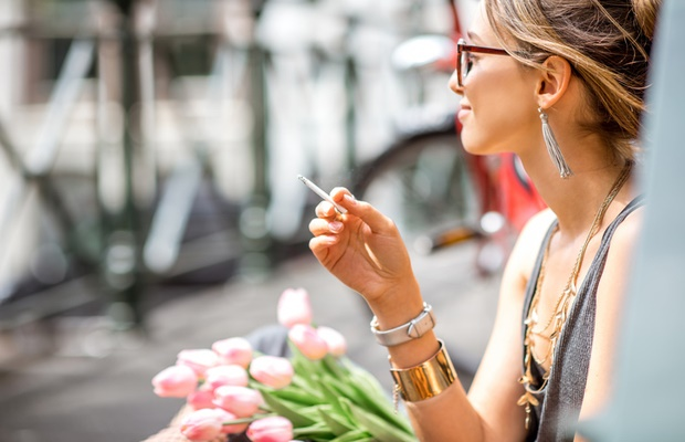 beautiful girl smoking a joint in Amsterdam